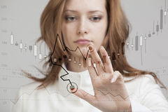 Finance data concept. Woman working with Analytics. Chart graph information with Japanese candles on digital screen. Stock Image