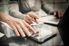 Finance department working process.Photo woman showing business reports modern tablet. Banker holding pen for signs Royalty Free Stock Photo
