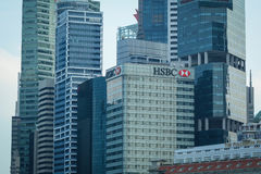Finance district in Singapore. Singapore - Jul 3, 2015. Top of modern buildings at finance district in Singapore. Singapore is the third-largest financial centre Stock Images