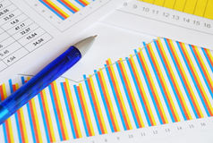 Finance documents. Top view of the blue pen on finance documents Stock Images
