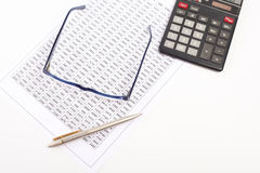 Finance documents. Finance document with blue glasses and gold pen Royalty Free Stock Photos