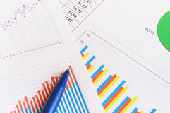 Finance documents. And blue pen Stock Photos