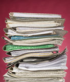 Finance documents on red background Stock Photo