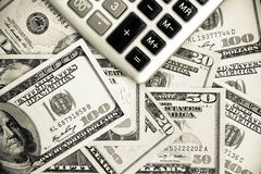 Finance, Dollar and calculator Stock Photo