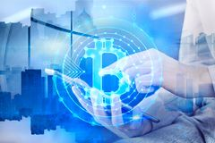 Finance and e-commerce concept. Side view of businessman hand using tablet with bitcoins on abstract city background. Finance and e-commerce concept. Double stock image