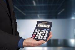 Finance and economics. Closeup of the calculator in hand, concept of finance and economics Stock Photography