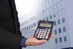 Finance and economics. Closeup of the calculator in hand, concept of finance and economics Stock Photos