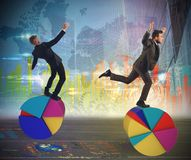 Finance and economy acrobats Stock Photos