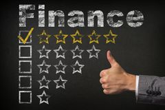 Finance five 5 star rating. thumbs up service golden rating stars on chalkboard royalty free stock image