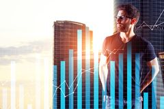 Finance and forex concept. Businessman with digital business chart on abstract city background. Finance and forex concept. Double exposure Stock Image