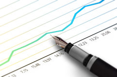 Finance Graph Pen. Royalty Free Stock Image