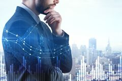 Finance and growth concept. Businessman with forex chart standing on abstract city background. Finance and growth concept. Double exposure stock image