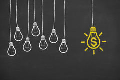 Finance Idea Bulb Concepts Working on Blackboard Royalty Free Stock Images
