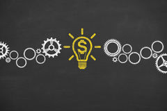 Finance Idea Bulb Conceptual Working on Blackboard Royalty Free Stock Images