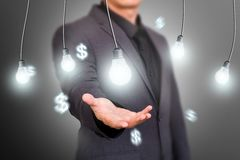 Finance Idea Concept Bulb on Virtual Screen Royalty Free Stock Photo