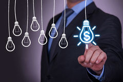 Finance Idea Concept Light Bulb on Screen. On working business concept Royalty Free Stock Image
