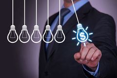 Finance Idea Concepts Bulb and Gear on Touch Screen Royalty Free Stock Images
