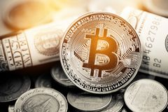 Finance investment risk concept: Stack of cryptocurrencies or bitcoin, Thai coin and US Dollar bill together. Cryptocurrency can. Uses designed as exchange on royalty free stock photography