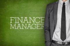 Finance manager on blackboard Stock Images