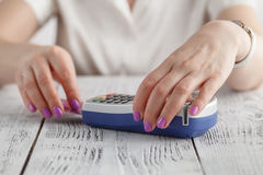 Finance, money, technology, payment and people concept - close up of hand inserting bank card to terminal Stock Photos