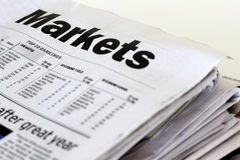 Finance newspapers. A stack of business newspapers on a white background Royalty Free Stock Image