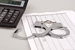 Finance, numerals, handcuffs and tables Royalty Free Stock Photography