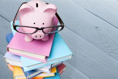 Finance. Piggy bank education book home s savings learning royalty free stock images