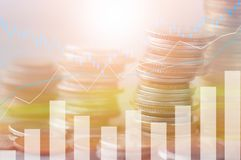 Finance, profit, capital banking and investment concept, Double. Exporsure stacked of coins and night city with graph Stock Image