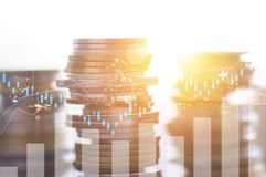 Finance, profit, capital banking and investment concept, Double. Exporsure stacked of coins and night city with graph Royalty Free Stock Photos