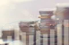 Finance, profit, capital banking and investment concept, Double. Exporsure stacked of coins and night city with graph Royalty Free Stock Image