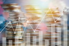 Finance, profit, capital banking and investment concept, Double. Exporsure stacked of coins and night city with graph Royalty Free Stock Photo