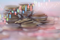 Finance, profit, capital banking and investment concept, Double. Exporsure stacked of money coins and night city with graph Stock Photos