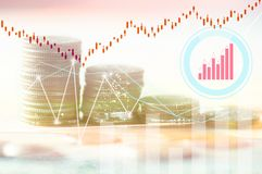 Finance, profit, capital banking and investment concept, Double. Exporsure stacked of coins and night city with graph Stock Images