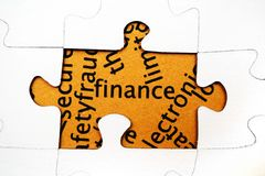 Finance puzzle concept. Close up of Finance puzzle concept Stock Images