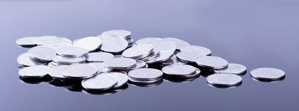 Finance reflection and business profit. Metal coins Royalty Free Stock Photo