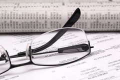 Finance report. Reading finance report with glasses Stock Image