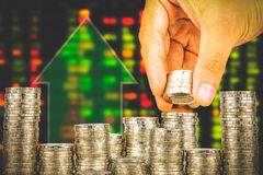 Finance and Saving money banking concept,Hope of investor concept,Male hand putting money coin like stack growing business. double. Exposure of blur background Royalty Free Stock Photo