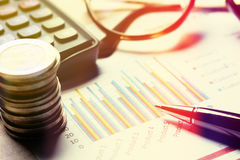 Finance savings concept, summary report chart with device financ Royalty Free Stock Photos