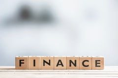 Finance sign on an office desk Royalty Free Stock Photos