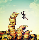 Finance skill. Falling businessman and euro coin pile Stock Images