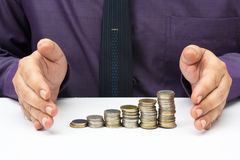 Finance stability. Hand protect heap coins for business or finance stability concept Stock Photo