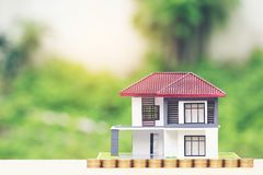 Finance, Stack of coins money and Model house on natural green background, Business investment and real estate stock photos