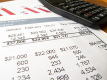 Finance statement data with calculator Royalty Free Stock Image