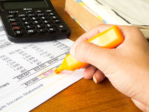 Finance statement data with calculator Royalty Free Stock Photo