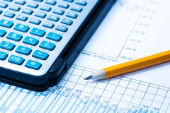 Finance Statistical graphs and calculator Stock Photos