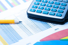 Finance Statistical graphs and calculator Royalty Free Stock Photography