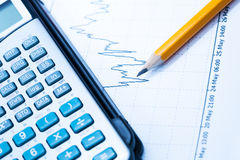 Finance Statistical graphs and calculator Royalty Free Stock Image
