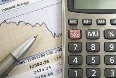 Finance and Stocks. Closeup image of stock market graph and calculator stock photo