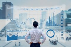 Finance trade manager analysing stock market indicators for best investment strategy, financial data and charts with business