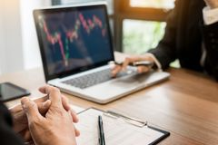 Finance trade manager showing reports screen analysis finance cu Royalty Free Stock Photos